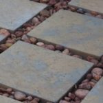 Contractors Flagstone installed with stones landscaping design
