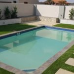 Ibanzi Paver walkway with grass, landscaping design and around the pool