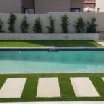 Ibanzi Paver walkway with grass, landscaping design and around yhe pool