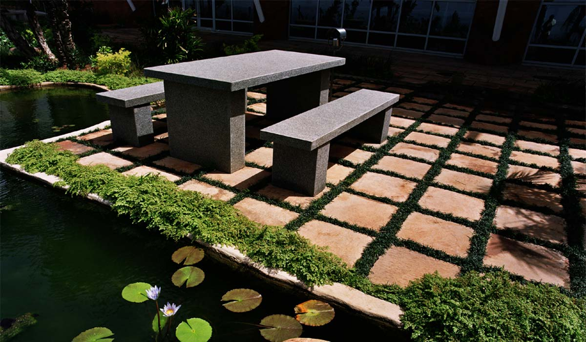 Straight edge paver installation on patio and landscape area