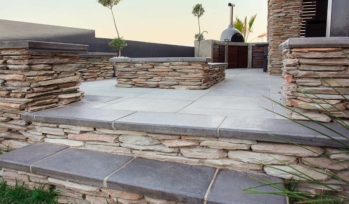 Natural Stone Cladding installed around a beautiful outdoor living space