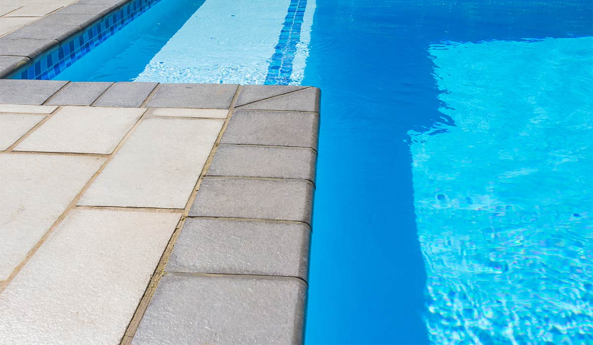 Shepstone coping installed around the pool